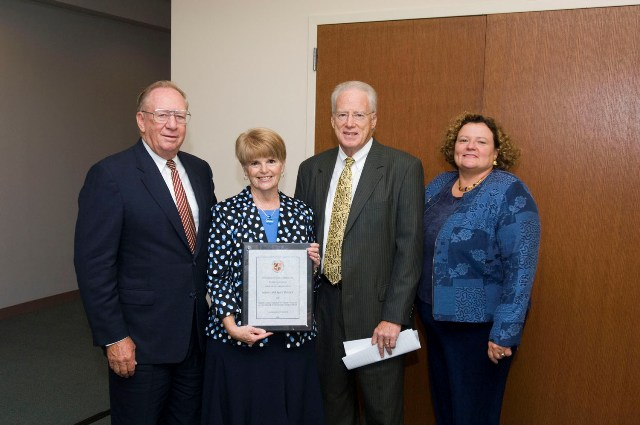 """From left: USM Board of Regents Chairman Clifford M. Kendall, Marylane McGlinchey, Chancellor William E. """"Brit"""" Kirwan and SU President Janet Dudley Eshbach."""