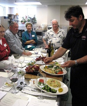 SU Alumnus Pete Roskovich leads a cooking class.