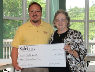 Salisbury University 2012 Employee of the Year Todd Smith receives a check from Provost and Senior Vice President of Academic Affairs Diane Allen.