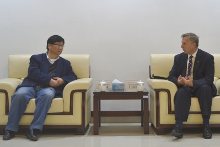 Foust (right) with West Anhui University's Provost