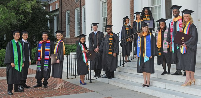 Graduates in front of Holloway Hall