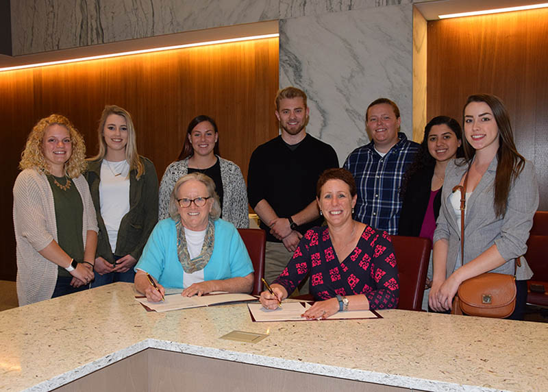 Pictured, from left, are Delaware Tech students Briana Giansanti, Sierra Schultheis, Kyra Webb, Jack Rothner, Savannah Brown, Karen Jimenez and Alissa Banks, along with SU Provost Diane Allen and Owens Campus Vice President Bobbi Barends.