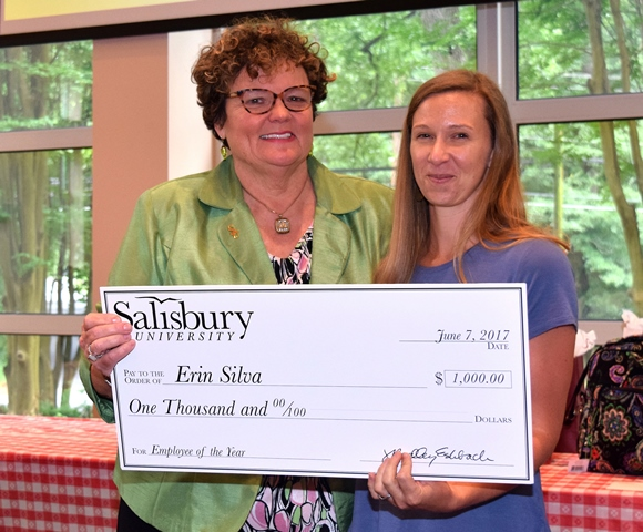 SU President Janet Dudley-Eshbach, left, presented 2017 Employee of the Year Erin Silva with a commemorative check.