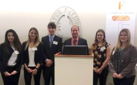 Pictured, from left: Students Allison Derman, Haily Curtiss, Dillon Lucas, Brandon Brittingham, Shelby Collins and Madison Myles, partering with Long & Foster Real Estate, presented their project to the Greater Salisbury Committee.