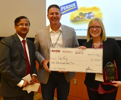 Pictured, from left:  Dr. Amit Poddar, MASMI director; and Geoff Turner, president and chief operating officer of Choptank Transport, presented a ceremonial check and award to inaugural sales competition winner Julia Rey.
