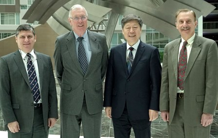Drs. Richard Hoffman, Oliver Roche and Frank Shipper with Zhang Ruimin
